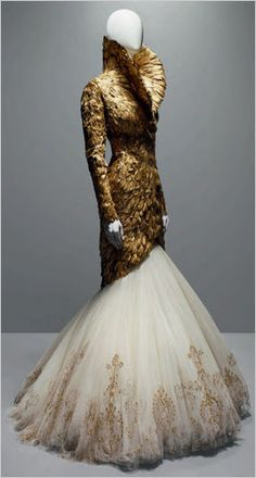 Alexander Mcqueen...Wow, GORGEOUS. Imagine wearing this on that special day. Get that designer look without the designer $$$, have it custom-made. Change to color to fit your wedding theme.