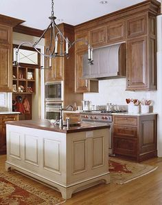 Not usually drawn to darker colors in the kitchen but love how warm and inviting this one is.