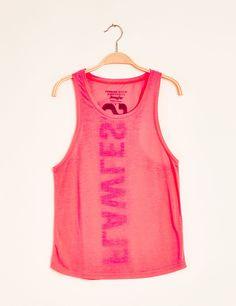 Débardeur fitness imprimé rose fluo et noir - http://www.jennyfer.com/fr-fr/collection/tops-et-tee-shirts/debardeur-fitness-imprime-rose-fluo-et-noir-10007604023.html