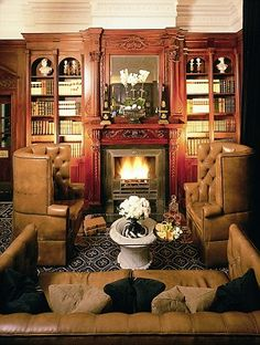Guests can peruse coffee table books piled up around the room as they sink back into comfy sofas while a fire roars