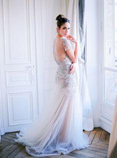 We're dazzled by this gown: http://www.stylemepretty.com/little-black-book-blog/2015/03/24/organic-elegant-paris-wedding-inspiration/   Photography: Le Secret D'Audrey - http://www.lesecretdaudrey.com/