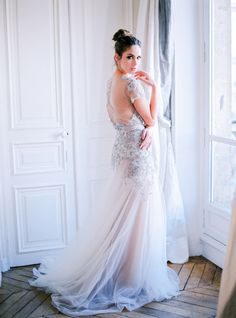 We're dazzled by this gown: http://www.stylemepretty.com/little-black-book-blog/2015/03/24/organic-elegant-paris-wedding-inspiration/ | Photography: Le Secret D'Audrey - http://www.lesecretdaudrey.com/