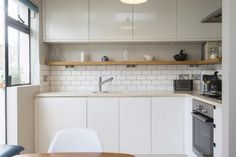 let's ignore the subway tiles and enjoy the cupboards and long shelf to keep it simple in this kitchen of a 1bed flat on Lyme Street, London NW1 - 34663249 - Zoopla