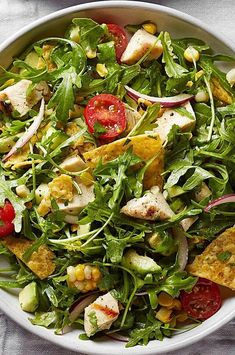 Peppery arugula, grilled corn and a tangy lime vinaigrette give this healthy taco salad recipe a serious upgrade. This recipe is the perfect vehicle for using the crushed-up tortilla chips at the bottom of the bag. #salads #saladrecipes #healthysalads #saladideas #healthyrecipes