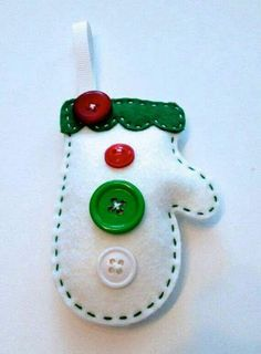 This cozy mitten ornament kit is a perfect craft to do this christmas! This kit includes the DIE CUT felt, buttons, thread, and ribbon. Felt Christmas Decorations, Felt Christmas Ornaments, Christmas Fun, Tree Decorations, Fabric Ornaments, Diy Ornaments, Rustic Christmas, Christmas Sewing, Christmas Projects
