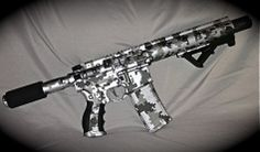 Sweet Tungsten and Black AR15 Pistol.  This is a 4-color digital camo that looks real cool on any platform.  Choose a smaller pattern for use on a handgun for a similar effect. www.madcustomcoating.com
