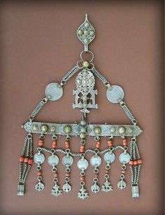 rare antique silver partially gilt Berber wedding head ornament from Fès, Middle Atlas, in Morocco. Early 20th century.  Embellished with small domes appliqués, coral beads and old spanish silver coins. The majority of the coins, including the two bigger ones at the top are from Isabel II and the others from Alphonse XIII.
