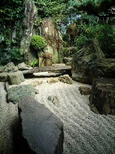 """Dry landscape garden, Daisen-in Temple, Kyoto, Japan. """"Daisen-in (大仙院?) is a sub-temple of Daitoku-ji, a temple of the Rinzai school of Zen in Buddhism, one of the five most important Zen temples of Kyoto. The name means 'The Academy of the Great Immortals.' Daisen-in was founded by the Zen priest Kogaku Sōkō (古岳宗亘?) (1464–1548), and was built between 1509 and 1513. Daisen-in is noted for its screen paintings and for its kare-sansui, or zen garden."""""""