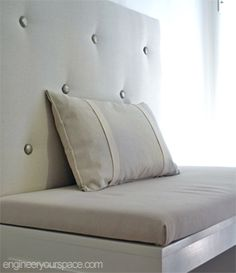 Banquette: How to build an upholstered panel with tufted buttons - same idea can be used to build DIY upholstered headboard & Learn how to create banquette seating by building an upholstered ... pillowsntoast.com