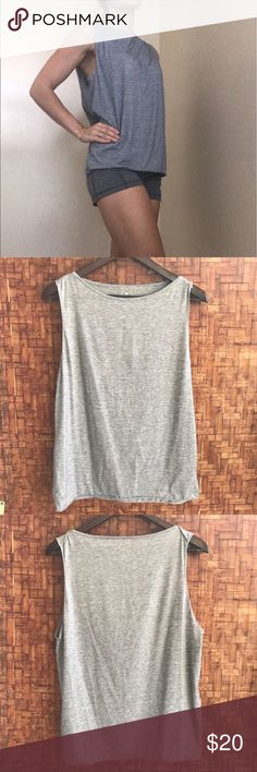 Athleta Tank Top Athleta Tank Top  • Lightweight & breathable material perfect for working out or warm weather  • Excellent condition - only sign of wear is a bit of missing stitching on shoulder (see last photo) • Blue/grey heather coloring  • Size small true to size   No trades please. Reasonable offers considered on items or bundles. Bundle discount 15% off 2 or more items ✨ Athleta Tops Tank Tops