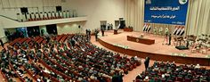 Iraqi newly elected parliament members attend the first session of parliament in Baghdad, Iraq, Tuesday, July 1, 2014. (Hadi Mizban/AP)