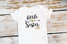 A personal favorite from my Etsy shop https://www.etsy.com/listing/454630846/little-sister-onesie-with-arrows-gold