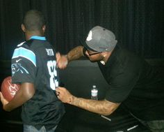 Steve Smith signing a jersey for 13-year-old Nail Credit: Lamesha via YourPics@wcnc.com #PanthersNation