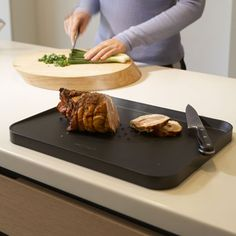 cutting board with angle to drain juices