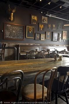 The frames on the wall is something we wanted to have in Sandy& Mismatching sizes and frames add to the comforting and local feel is part of Pub interior - Pub Design, Restaurant Design, Restaurant Bar, Modern Restaurant, Oriental Restaurant, Bar Interior Design, Cafe Bar, Bar Deco, Tapas Bar