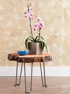 Invite the outdoors into your home with this super simple DIY project. Perfect for an eclectic feel, this side table is made with a wood slice and hairpin legs.