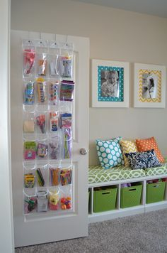 Pinned it, got it...I got this clear shoe organizer to hang on the inside of the playroom closet door & hold all of the twins art supplies. I love that you can see all the art supplies as soon as you open the door & it has plenty of storage for scissors, colors, paints, etc - TR