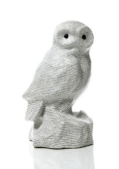 Snowy owl covered in book print by Haiti-Faire @ ideelie