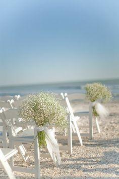 beach wedding with a bunch of babies breath flowers