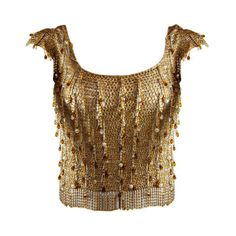 """whatwouldkhaleesiwear:  """" whatwouldkhaleesiwear:  """" What Would Khaleesi Wear?  Loris Azzaro - 1970's Loris Azzaro Gold Beaded and Chain Sweater  """"  I love this top. The integration of chain mail with gold beading and the textured effect evokes this image..."""
