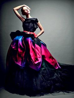 This Italian model is wearing a very elegant and colorful evening gown.  This full and very big dress is a style for Italian women to wear to a fancy occasion.