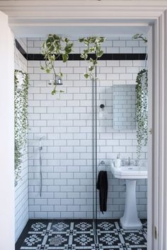 Floor-to-ceiling metro tiles and a Victorian-style floor put a period spin on this modern wet room. #BathroomIdeas #BathroomDecor #Monochrome