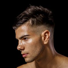 "A new men's hair trend for 2014 is this undercut that fades into skin about 2"" above the hairline."