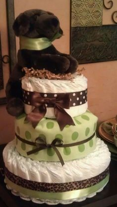 Diaper Cake- I LOVE the idea of covering one tier with a blanket!