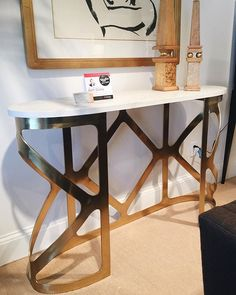 Spotted at #hpmkt! @bethdotolo's Style Spotted the Grand Tour Buccellati Bangle Console by @centuryfurniture. It like a beautiful piece of jewelry, trending in marble and angular brass. Always exquisite details and style that we can bring to our clients at Century! #hpmktSS #hpmktcoveredincryptonhome