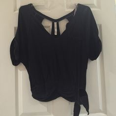 Free People short sleeve open back top Black cotton top. Open back with tie on the side. No size listed but fits like a small Free People Tops