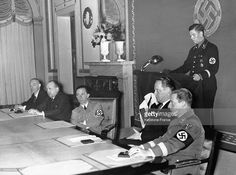 SS-standartenführer Ingemar Alfred Berndt conducts a speech at a political gathering at the House of Reichs Culture to members of the Reichsministry of Public Enlightenment. In his presence is Franz Moraller, Hans Hinkel, Joseph Göbbels and Walther Funk. Berlin, German Reich. November 28th, 1936.