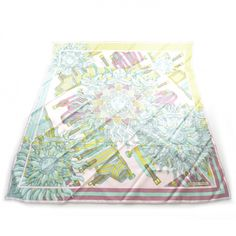 This is an authentic HERMES Silk Sangles de Phoebus Scarf 90.   This stunning graphically detailed 100 silk scarf features multicolor bold bursting suns.