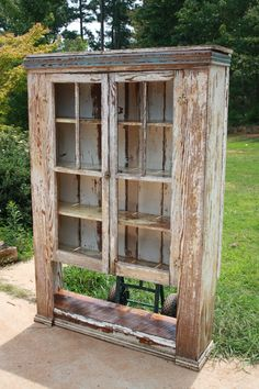 Primitive hutch that I reworked ,new back and bottom shelf