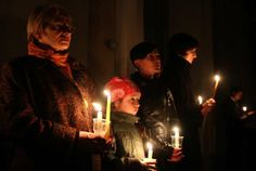 People light candles during an Easter vigil mass in the Cathedral in Vilnius, Lithuania,on April 19, 2014.