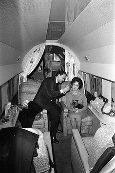 Elizabeth Taylor having her hair styled by Alexandre on a private plane, 1958