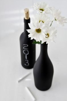 For the entrance table where guests sign in, sunflowers. Chalk board paint on bottles.