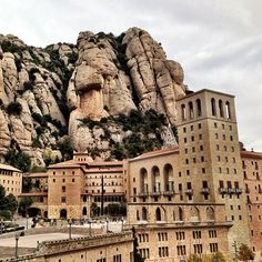 Monserrat, not far from Barcelona.  When we saw it in early spring, the fog enshrouded the rocks and buildings but even still, it was spectacularly beautiful.