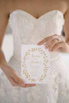 Gold and white wedding invitation: http://www.stylemepretty.com/destination-weddings/2016/08/25/dreamy-beach-wedding-style-session-at-celebrity-destination/ Photography: Darinimages - http://www.darinimages.com/