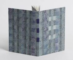 Paste paper, stitching and inlaid leather.