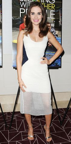 Alison Brie struck a pose at the Sleeping With Other People screening in a white lace midi-length dress with a sheer hem and waist-defining black panels. The finishing touch? Silver metallic Aldo sandals.