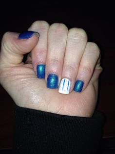 Blue nails with white and silver stripes