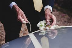 A photojournalistic photograph of the brides grandfather tying a flower to her wedding car before her wedding in Boston, Massachusetts Gina Brocker Photography Wedding Car, Garden Wedding, Classic Garden, Documentaries, Groom, Wedding Photography, Boston Massachusetts, Laughter, Brides