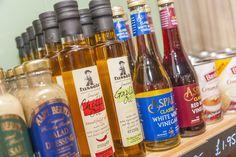 oil and vinegar. local produce at Cheddar Woods Holiday Home Park. Cheddar Gorge, Farm Shop, White Vinegar, Somerset, Resort Spa, Vodka Bottle, Woods, Oil, Park