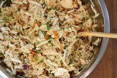 asian chicken salad (slaw)  1 lb. boneless skinless chicken breasts (chopped and grilled)  2 pkgs ramen noodles (oriental flavor)  1 bag shredded cabbage  1 shredded broccoli slaw  1 bunch green onions, chopped  2 tbsp. toasted sesame seeds  1 cup almonds (sliced or slivered), toasted    dressing:  1 pkg of ramen seasoning  1/2 cup oil  1 tbsp. sugar  1 tsp. salt  1/2 tsp. pepper  1/4 cup of rice vinegar  2 tbsp. soy sauce    cook chicken. mix dressing. throw together and toss! it's ju...