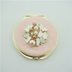 Pearl Butterfly Compact Mirror/Pink Valentine's Day gift This little butterfly decored compact mirror is a perfect gift for lady. It is covered with pink  enamel glaze and mounted with bling-bling crystals and elegant pearls.