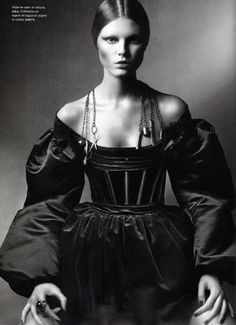 c. 1850s Corset, off the shoulder neckline, full sleeves. Shiny fabric similar to lustrous silk. Dolce & Gabbana