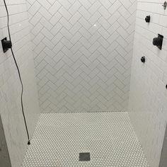 Classic subway tile with a herringbone design and . - Classic subway tile with a herringbone design and . White Subway Tile Shower, Subway Tile Showers, Shower Floor Tile, Bath Shower, Herringbone Subway Tile, Beveled Subway Tile, Penny Round Tiles, Penny Tile, Bathroom Installation