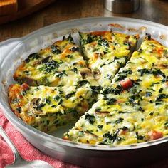 Crustless Spinach Quiche Recipe -I served this dish at a church luncheon and I had to laugh when one gentleman told me his distaste for vegetables. He, along with many others, were surprised how much they loved this veggie-filled quiche! —Melinda Calverley, Janesville, Wisconsin