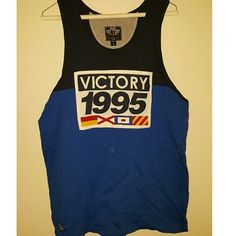 MENS 10 DEEP VICTORY TANK TOP BLUE sz medium this is an authentic 10 deep mens tank top. never worn. without tags. that is not a small gray mark in the first picture its from my camera. fits a small but is a medium. can be worn by a female. blue color and navy blue. 10 deep Tops Tank Tops
