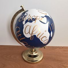 This hand painted world globe would be the perfect gift for a travel lover. This globe would also be ideal for a home office, dorm room or nursery.  The globe is painted navy blue and white with gold lettering and base. The dimensions are approximately 12 x 9 with the globe itself being 8 in diameter.  If you would like a different color or quote just let me know and I would be happy to customize it.   **Please allow 2-3 weeks before the globe is ready to ship**  Follow links below for…